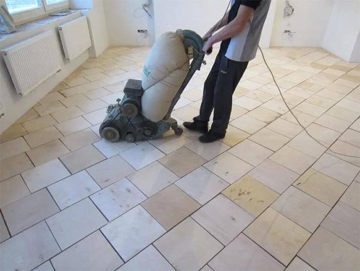 Hardwood flooring installation grinding the base