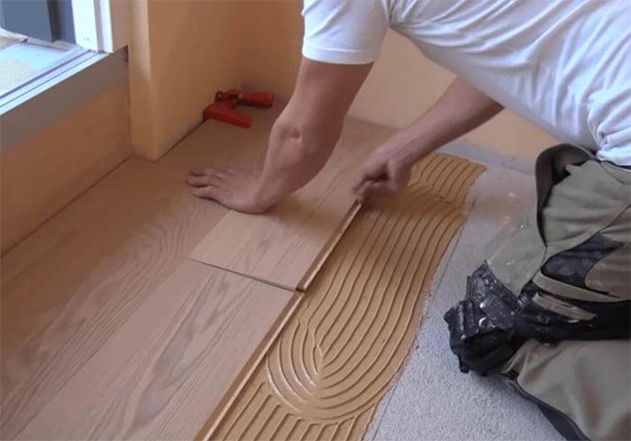 Hardwood flooring installation laying the flooring