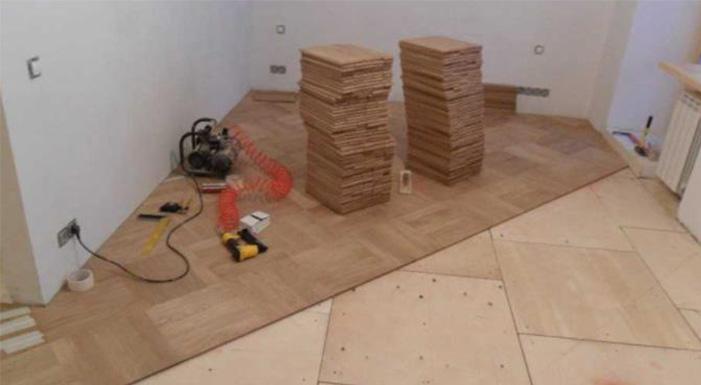 Hardwood flooring installation plywood laying
